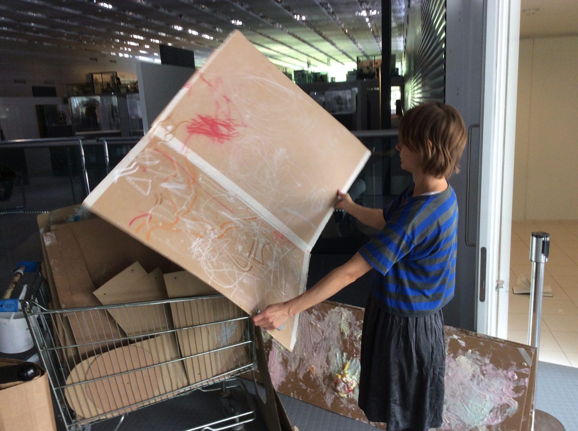 cardboard sheet, person, shopping trolley