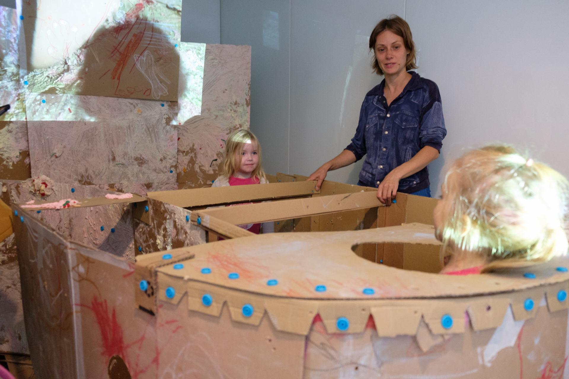 cardboard, child's head, hole