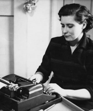 Doris Lessing at a typewriter