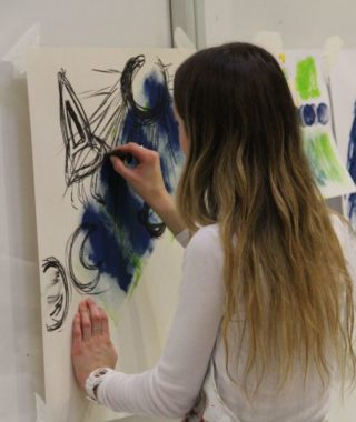 student painting at the Sainsbury Centre