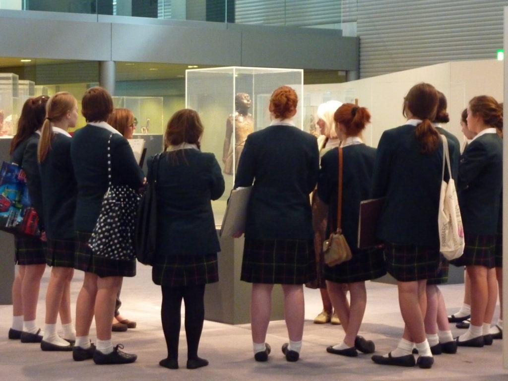 School group looking at Edgar Degas' Little Dancer sculpture at the Sainsbury Centre