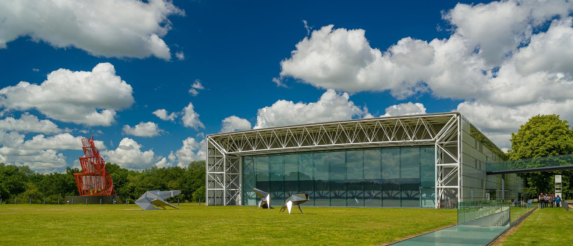 Sainsbury_Centre_East_end_exterior_with_-Beasts_sculptures_and_Tatlins_Tower_photo_Andy_Crouch