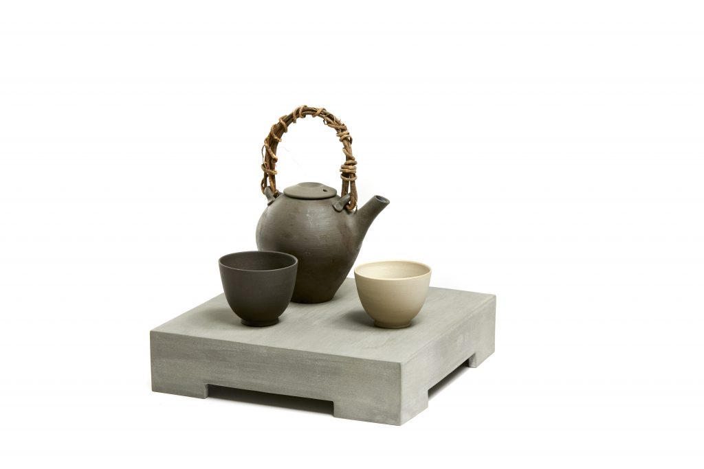 A teapot, two cups and a stand by Julian Stair