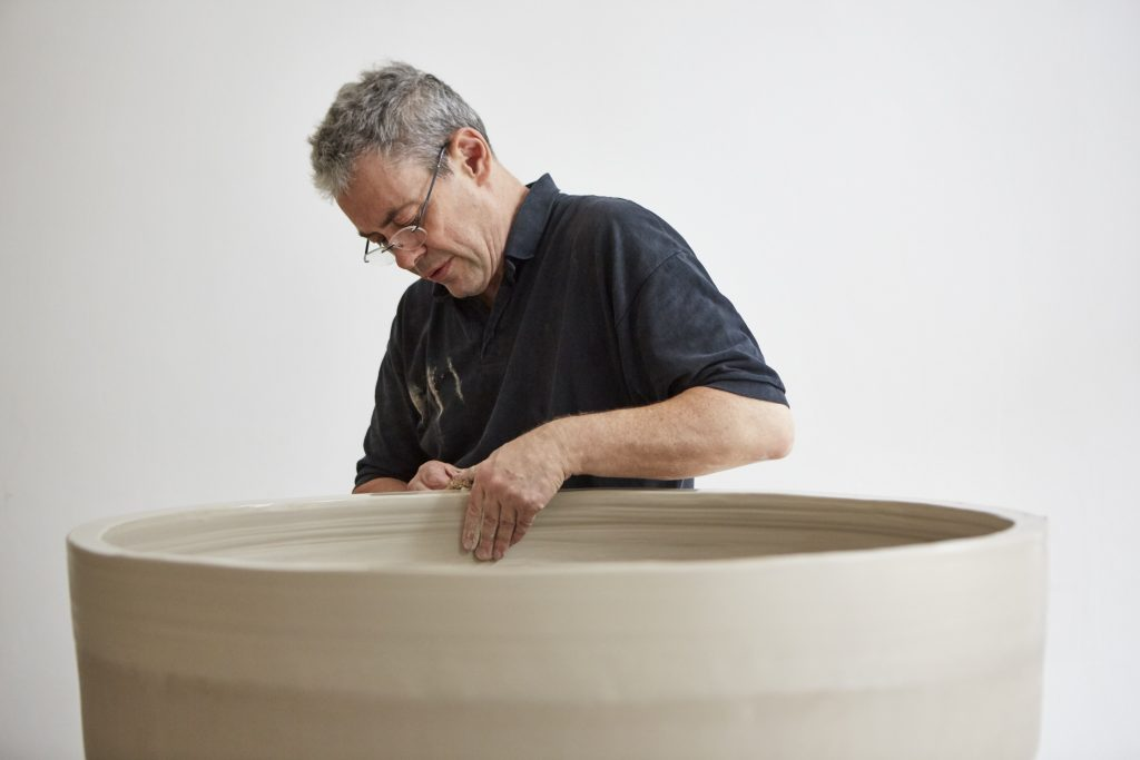 Photograph of Julian Stair working on a large cup in his studio