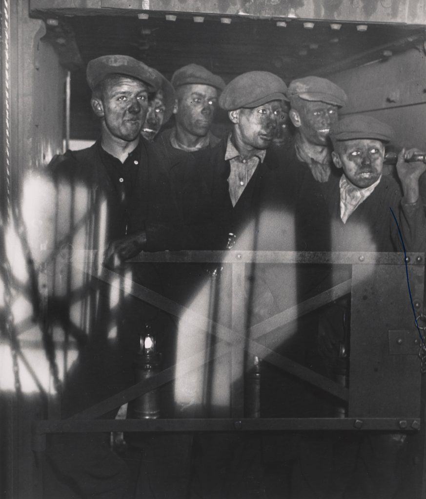 Black and white photograph of miners