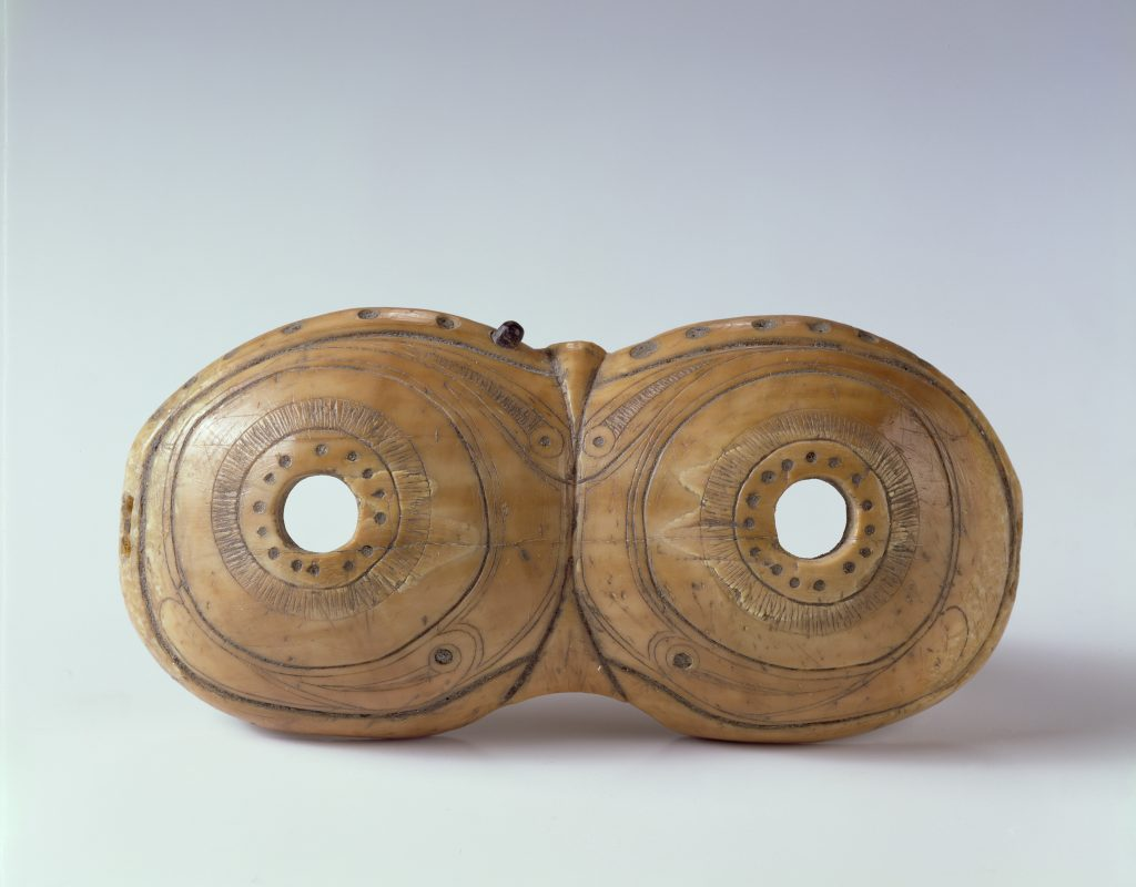 Carved walrus ivory snow goggles resembling owl eyes