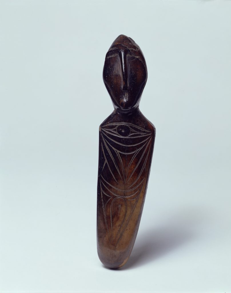 Carved walrus ivory figurative sculpture