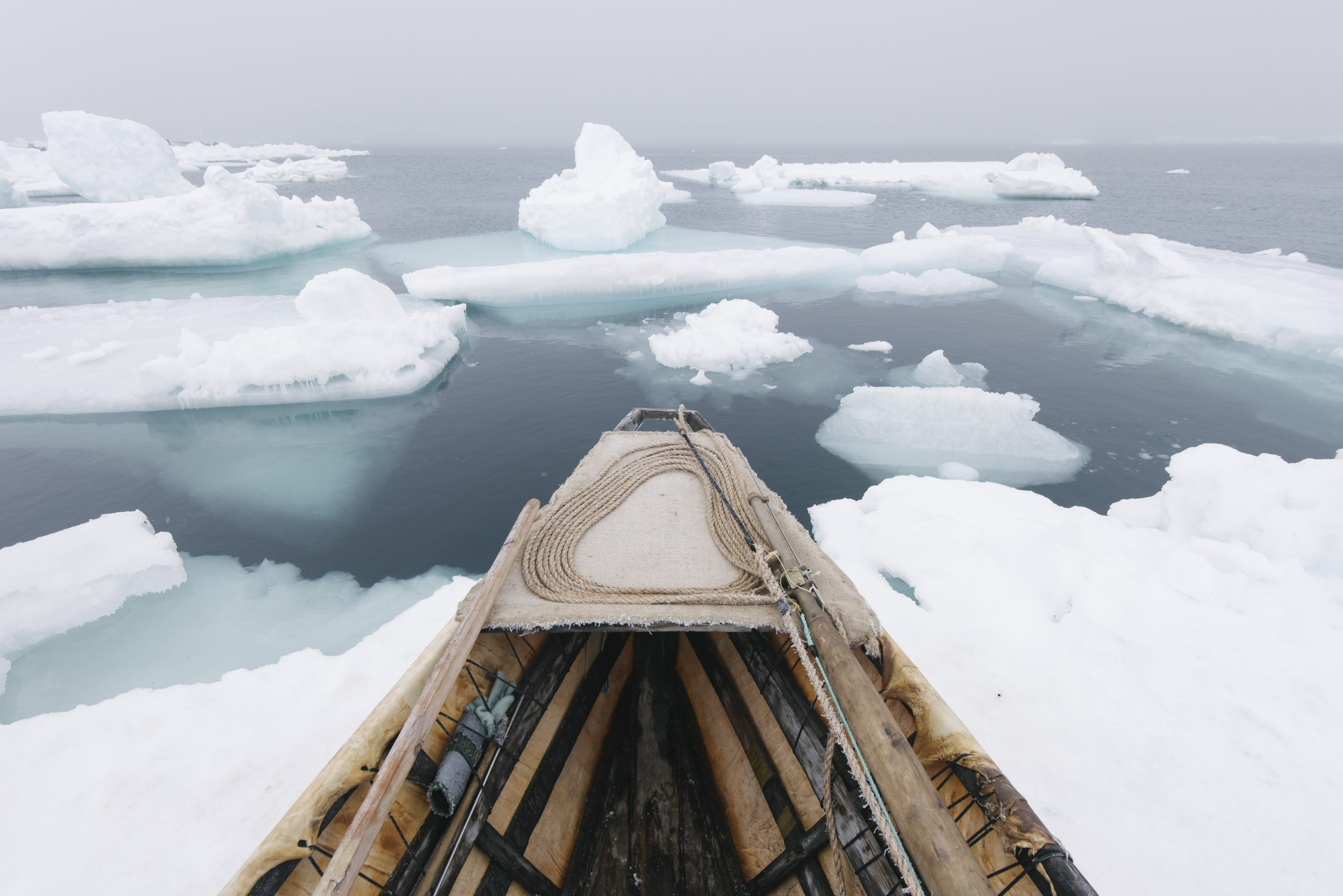 A photograph of a boat in the Arctic