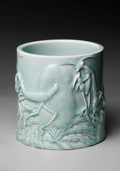 A carved brush pot created by Spitting Image co-creator Roger Law and his collaborator Mr Wu Song Ming
