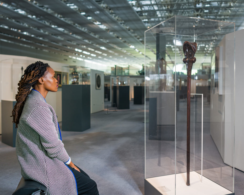 Photograph of South African artist Sethembile Msezane with an object from the Sainsbury Centre's collection