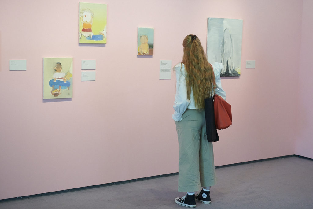 A visitor looking at exhibits by artist Leiko Ikemura at the Sainsbury Centre