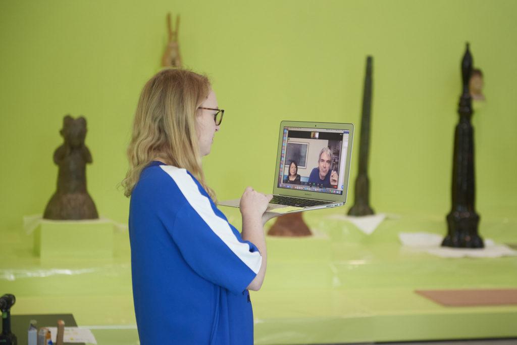 Photograph of Sainsbury Centre chief curator Tania Moore on a Zoom call with artist Leiko Ikemura and Ikemura's partner and frequent collaborator Philipp von Matt